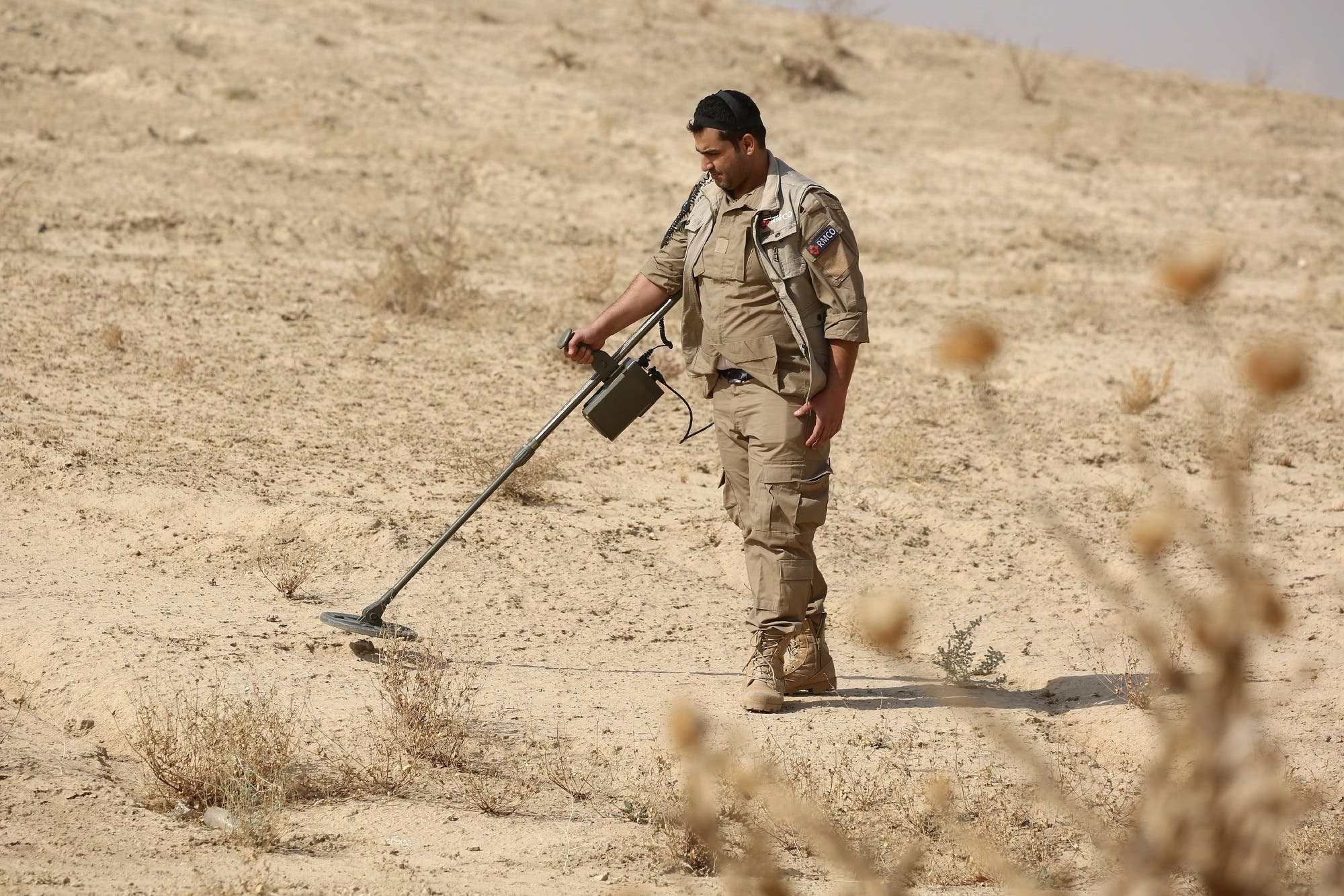 A Syrian member of the Roj mine clearing organization works at removing IEDs and mines planted by ISIS in Hassakeh province, on October 27, 2016. (AFP)