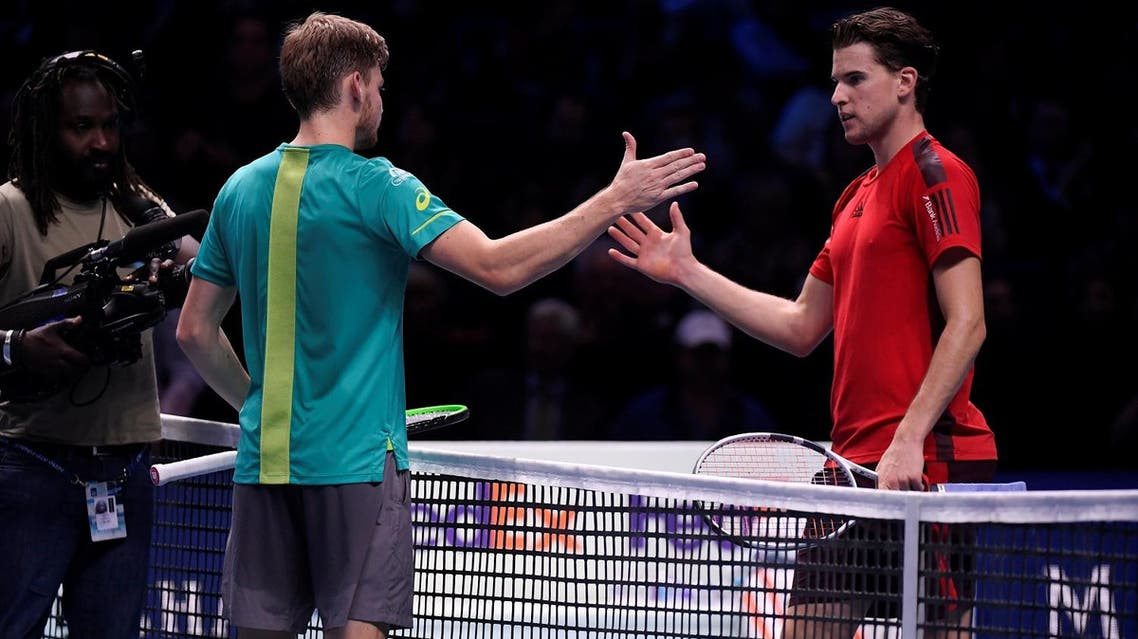 Belgium's David Goffin and Austria's Dominic Thiem after their group stage match. (Reuters)