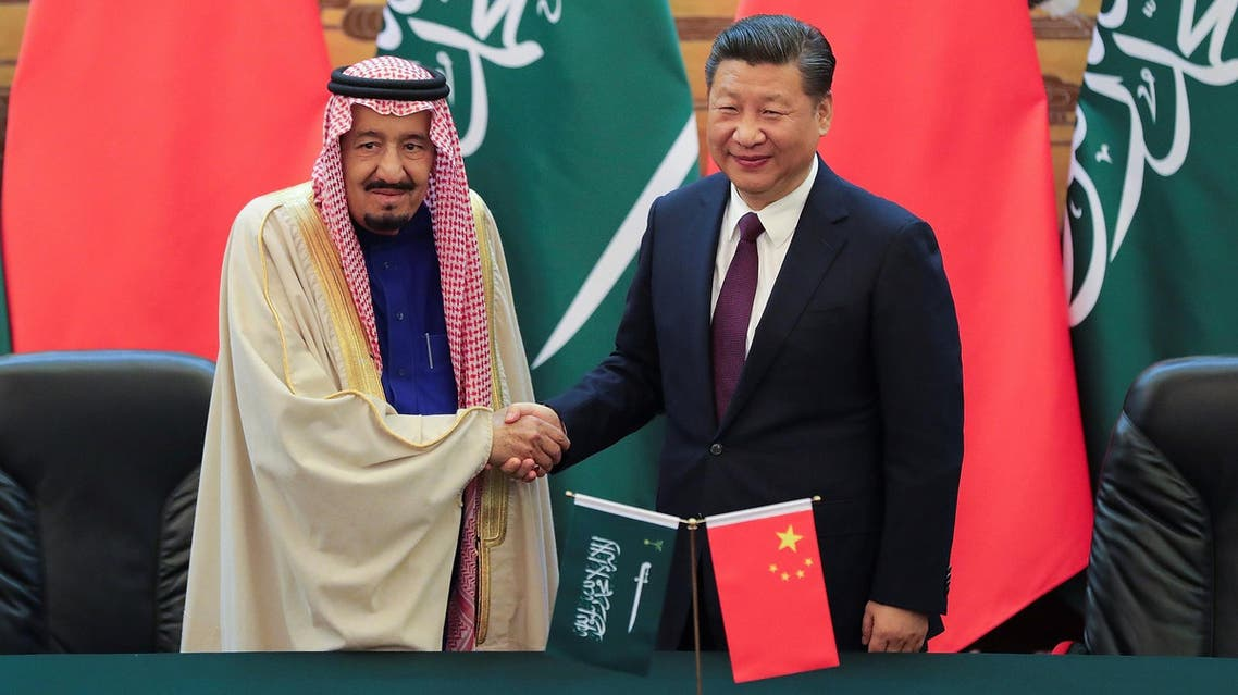 President Xi Jinping (R) and King Salman shake hands during a signing ceremony at the Great Hall of the People in Beijing on March 16, 2017. (Reuters)
