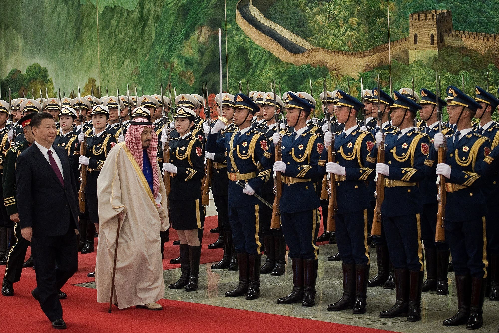 Saudi King Salman reviews an honor guard with Chinese President Xi Jinping (L) in Beijing on March 16, 2017. (AFP)
