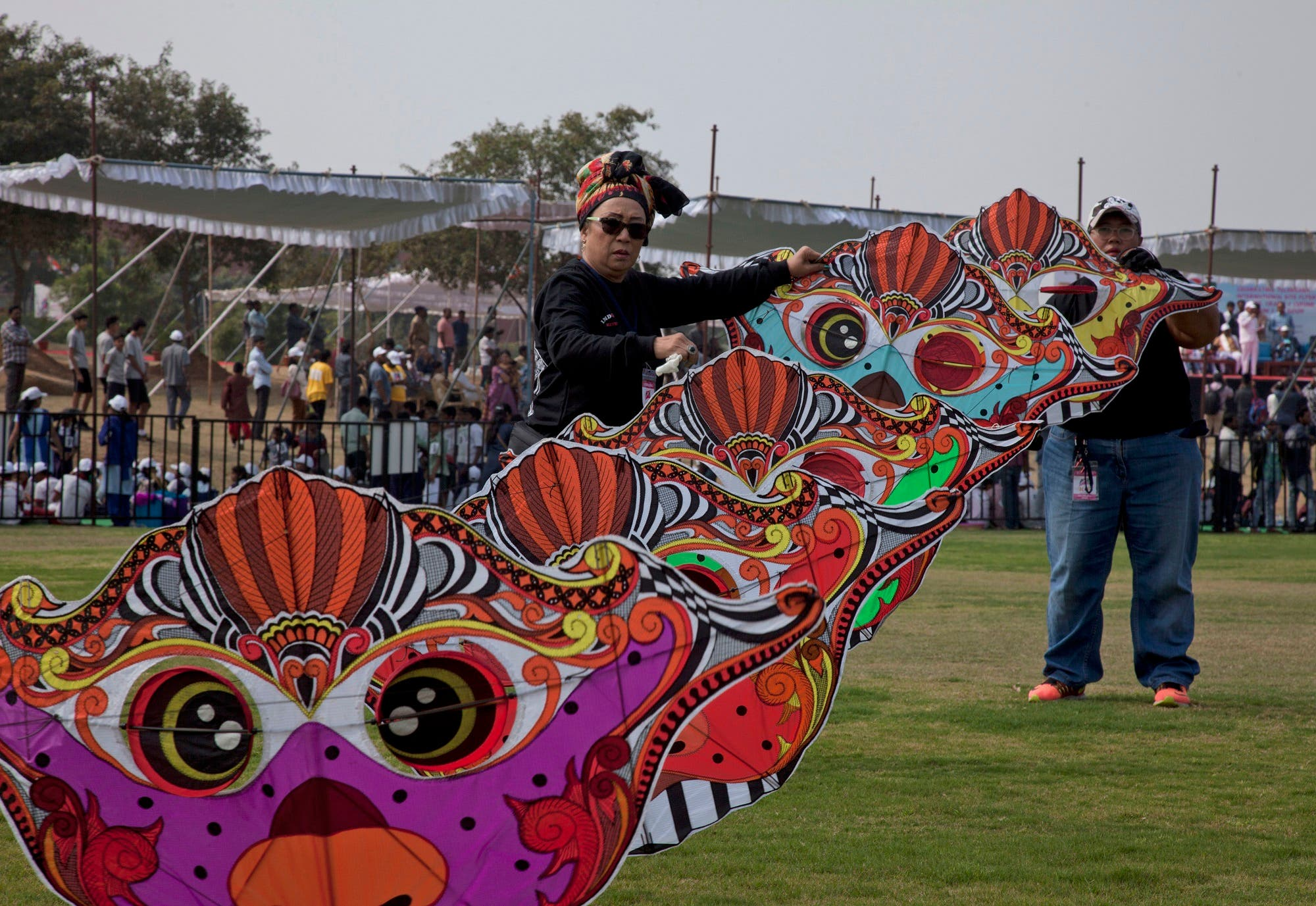 Participants fly a giant kite during the International Kite Festival on the outskirts of Hyderabad, India, on Jan. 13, 2017. (AP)