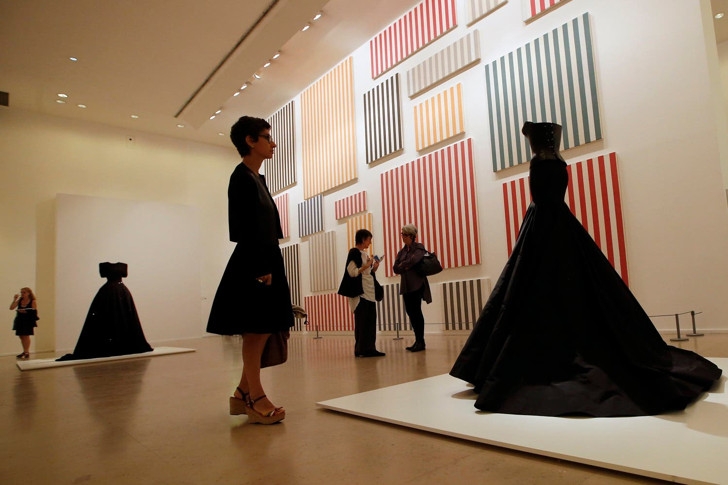 """A visitor looks at """"Bustier crocodile"""" of Haute Couture Spring Summer 2003 collections by French Tunisian born Fashion designer Azzedine Alaia, presented for the first Paris retrospective of couturier at Museum of Modern Art in Paris, on  Sept. 25, 2013. (AP)"""