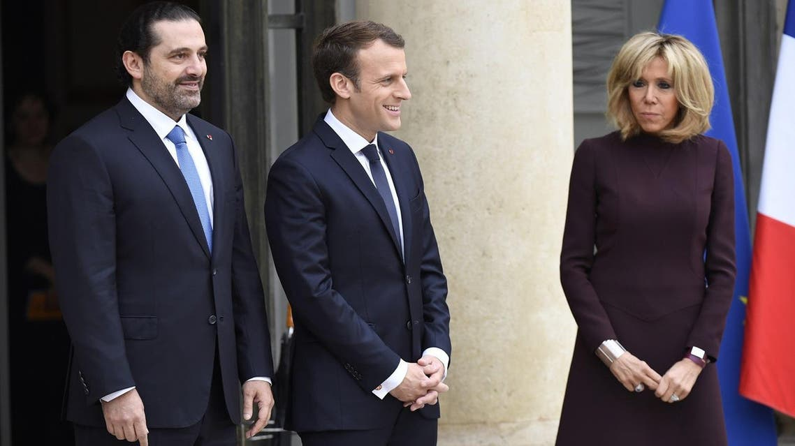 French President Emmanuel Macron (C) and his wife Brigitte Macron (R) welcome Lebanese Prime Minister Saad Hariri (L), at the Elysee Presidential Palace on November 18, 2017 in Paris. (AFP)