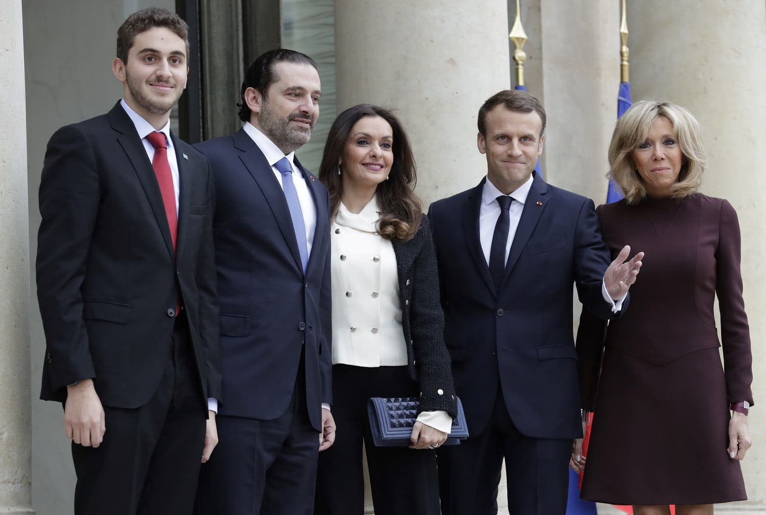 French President Macron (4R) and his wife Brigitte Macron (R) welcome Lebanese Prime Minister Saad Hariri (2R), his wife Lara Bachir El-Alzm (3R) and their son Houssam (L) at the Elysee Presidential Palace on November 18, 2017. (AFP)