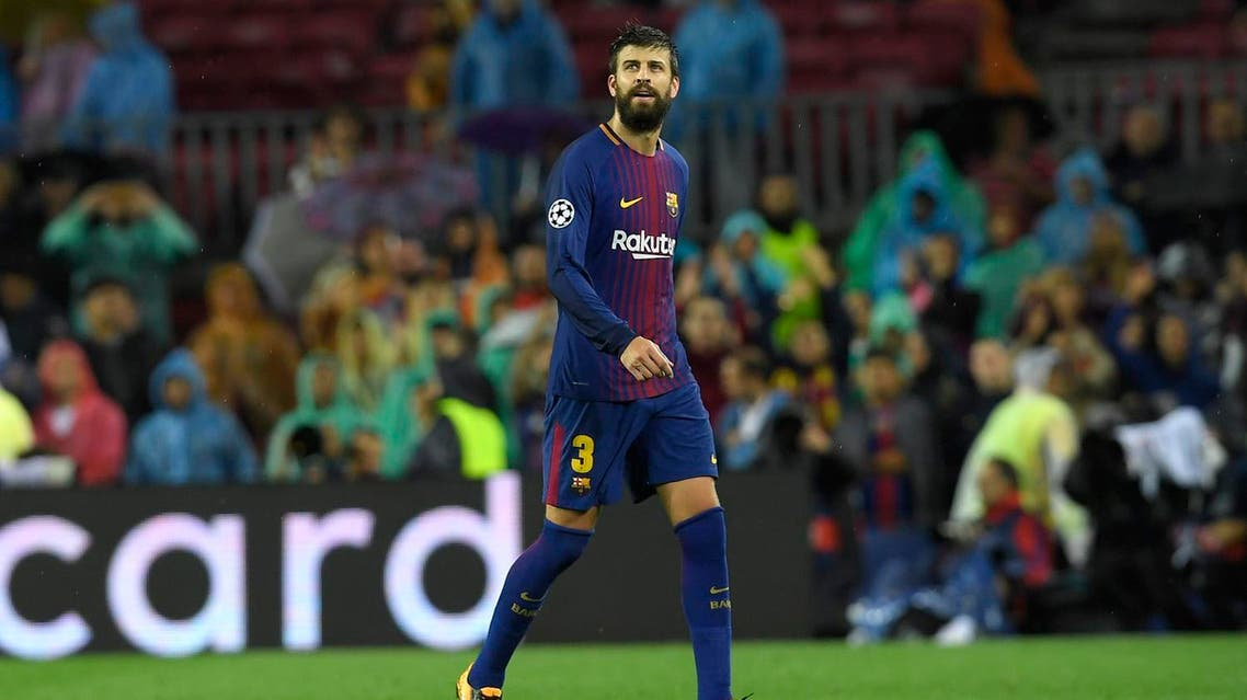 Barcelona's Spanish defender Gerard Pique leaves the field after receiving his second yellow card during the UEFA Champions League group D football match FC Barcelona vs Olympiacos FC at the Camp Nou stadium in Barcelona on Ocotber 18, 2017. (AFP)