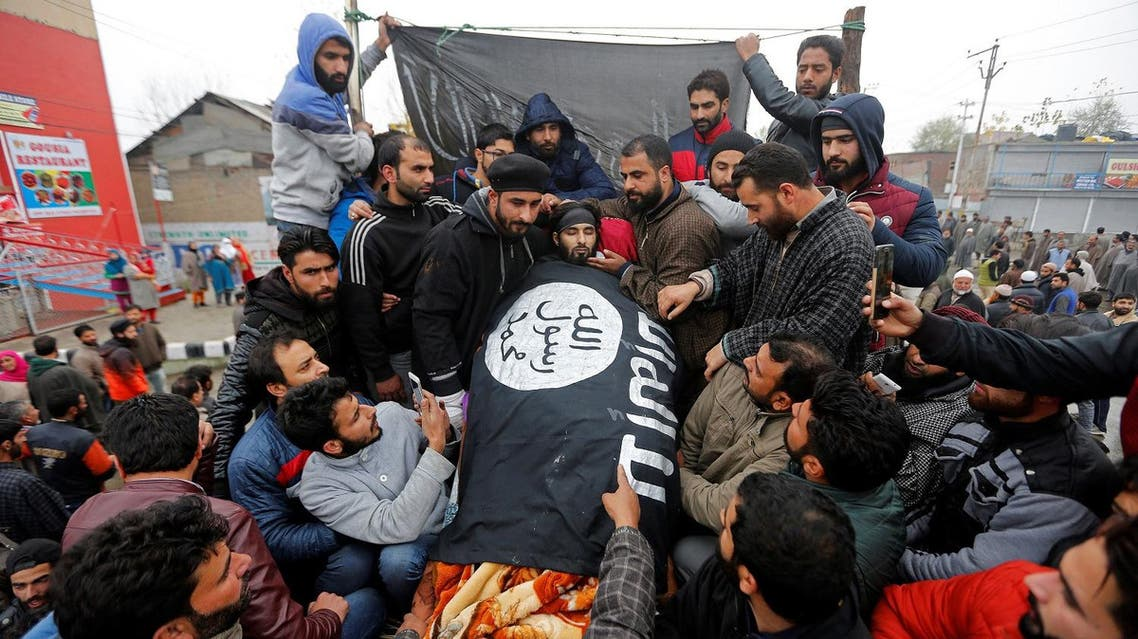 People gather around the remains of Mugees Mir, a suspected militant who according to local media was killed in an encounter with the Indian security forces in Zakura, during his funeral in Srinagar, November 18, 2017. (Reuters)