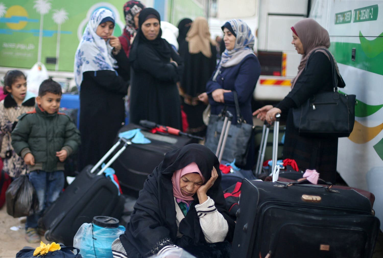 Palestinians wait for travel permits to cross into Egypt, for the first time after Hamas ceded Rafah border crossing to the Palestinian Authority, in Khan Younis in the southern Gaza Strip November 18, 2017. (Reuters)