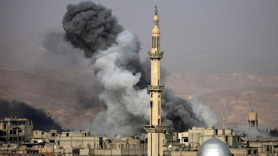 Smoke rises following an air strike on the rebel-held besieged town of Arbin, in the Eastern Ghouta region on the outskirts of Damascus, on November 18, 2017. (AFP)