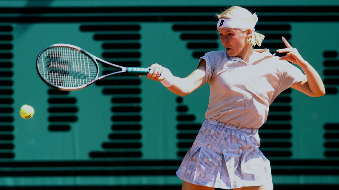 ana Novotna of the Czech Republic returns a forehand to compatriot Adriana Gersi during their match on the second day of the Roland Garros French tennis open. (Reuters)