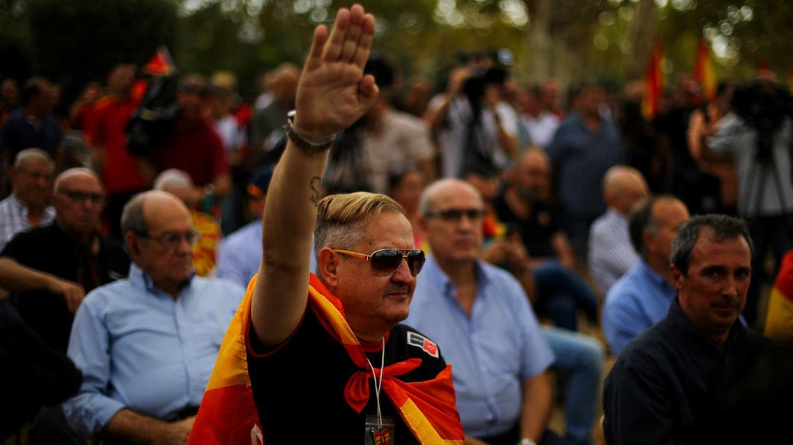 An ultra right wing demonstrator salutes during Spain's National Day in Barcelona on October 12, 2017. (Reuters)