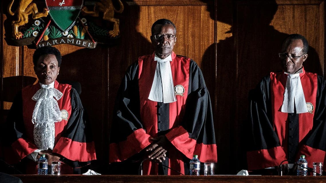 Kenyan Chief Justice David Maraga (C) and judges stand prior to speak as the Kenya's Supreme Court on November 20, 2017 dismissed two petitions to overturn the country's October 26 presidential election. (AFP)