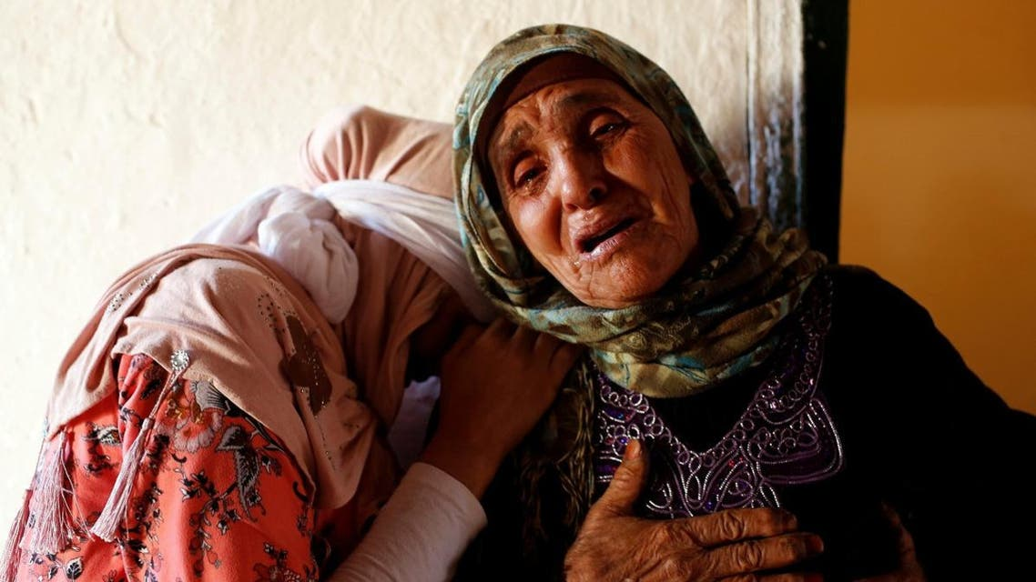 Relatives mourn the death of Lakbira Essabiry, one of the people who were killed when a stampede broke out in the southwestern Moroccan town of Sidi Boulaalam as food aid was being distributed in a market, in Sidi Boullaalam. (Reuters)