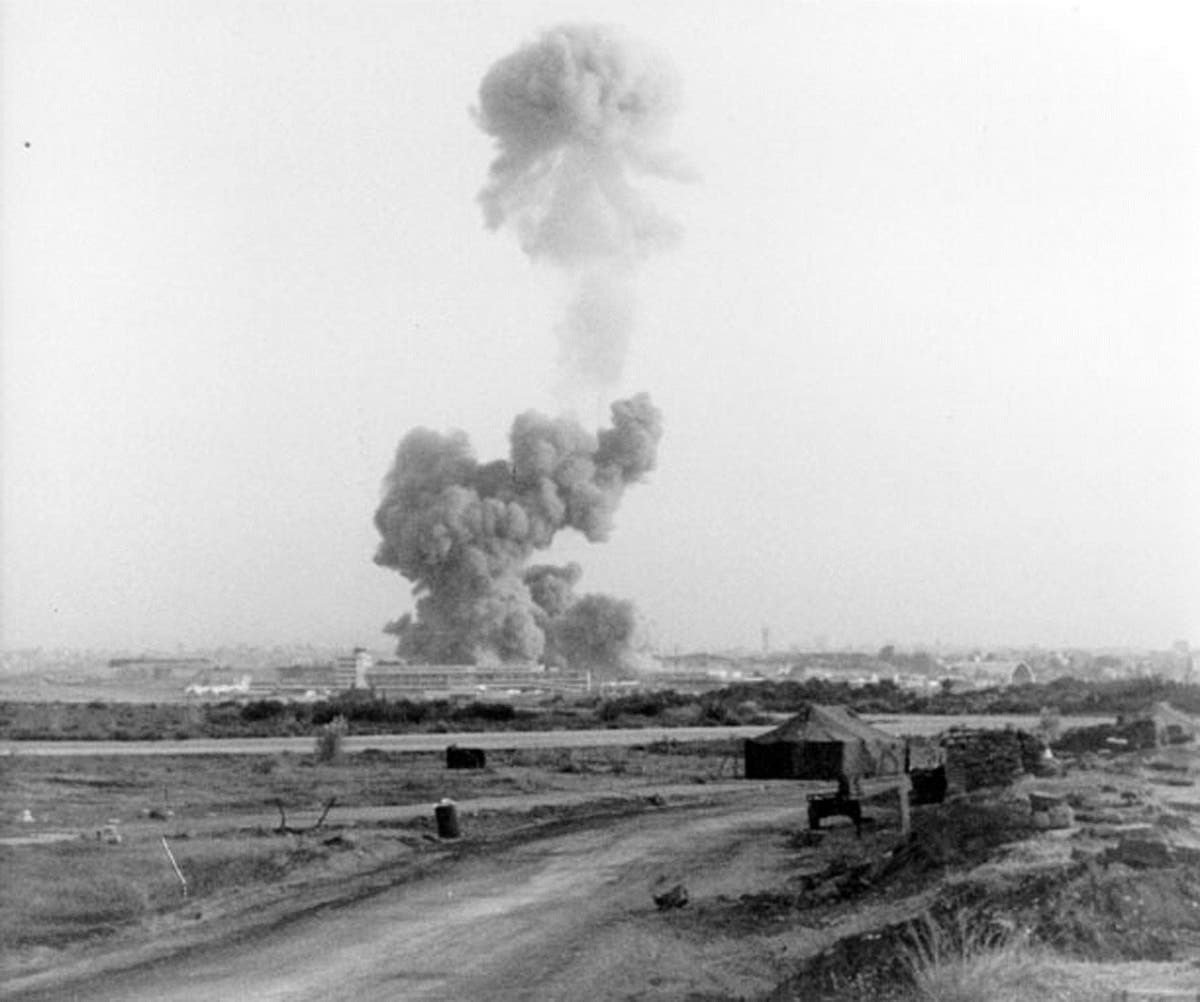 A cloud of smoke rises after the explosion of the Marine Corps building in Beirut, Lebanon October 23, 1983. (Reuters)