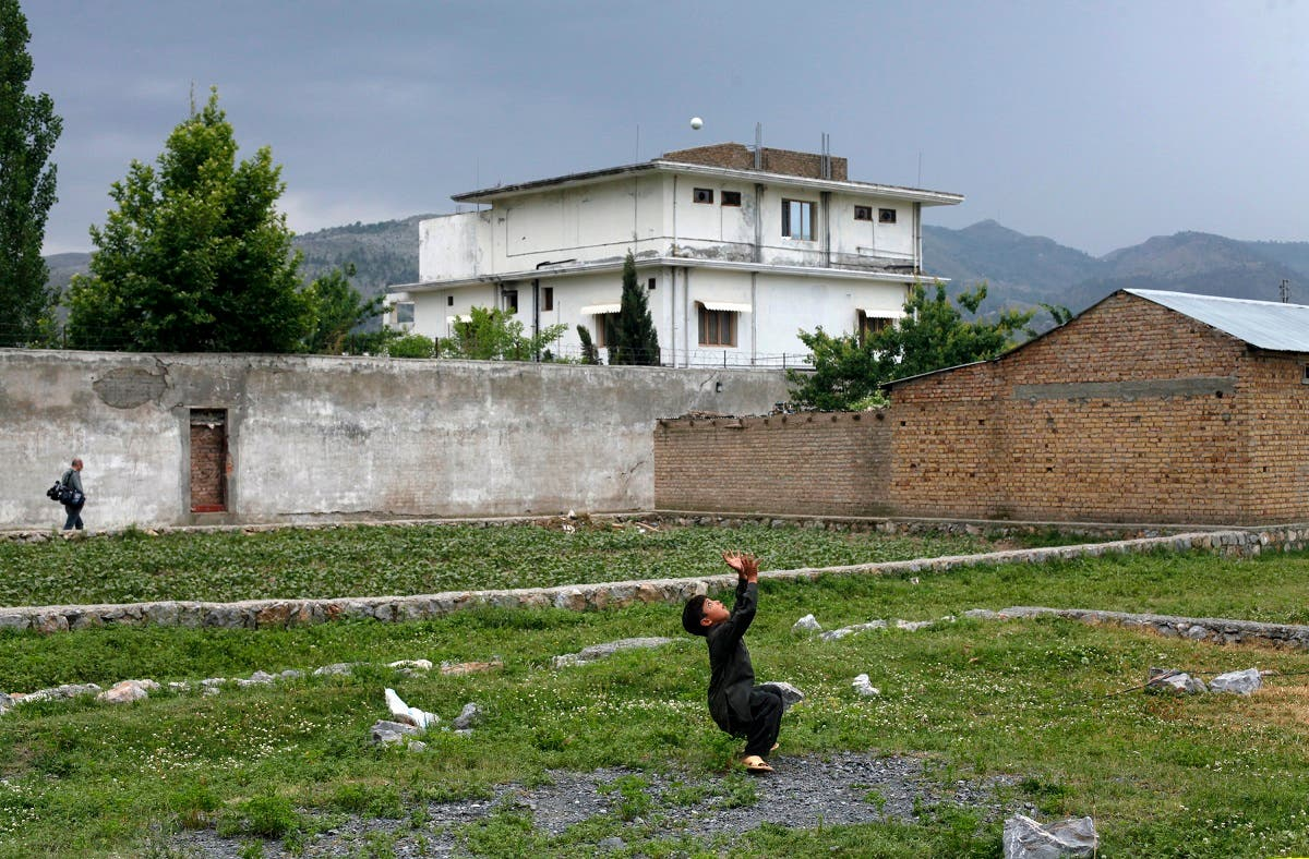 A boy plays with a tennis ball in front of Osama bin Laden's compound in Abbottabad in this May 5, 2011 file picture. (Reuters)