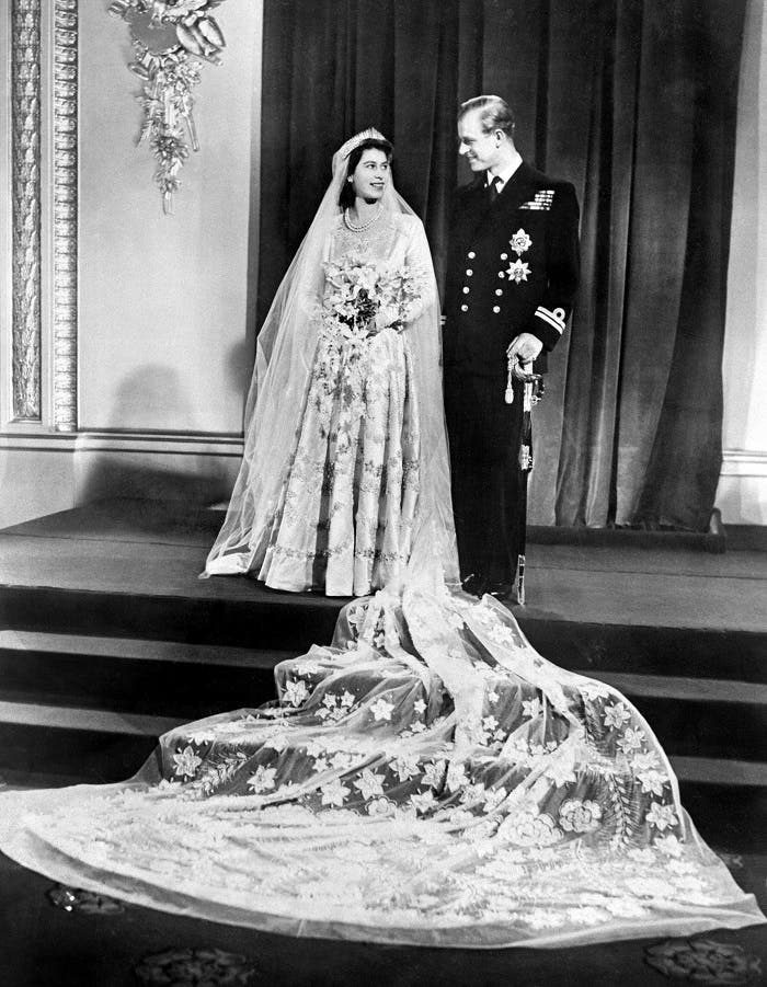 Princess Elizabeth (future Queen Elizabeth II) and Philip Duke of Edinburgh pose on their wedding day, 20 November 1947 in Buckingham Palace. (AFP)
