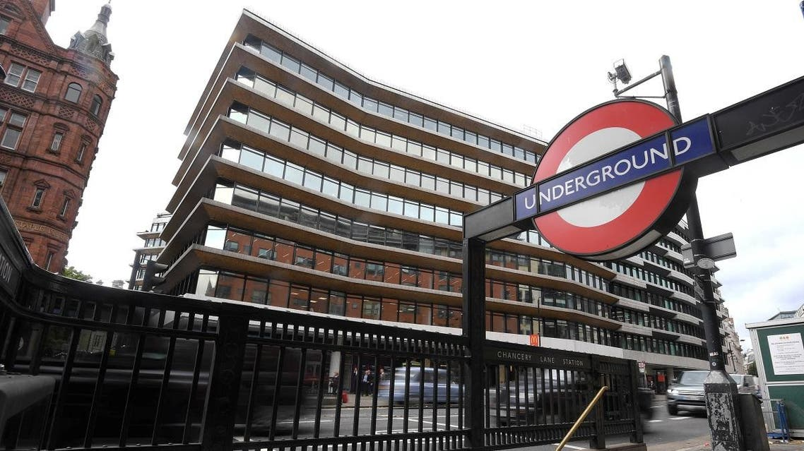 An office building containing the London headquarters of the PR company Bell Pottinger is seen behind an entrance to an underground train station in London. (Reuters)