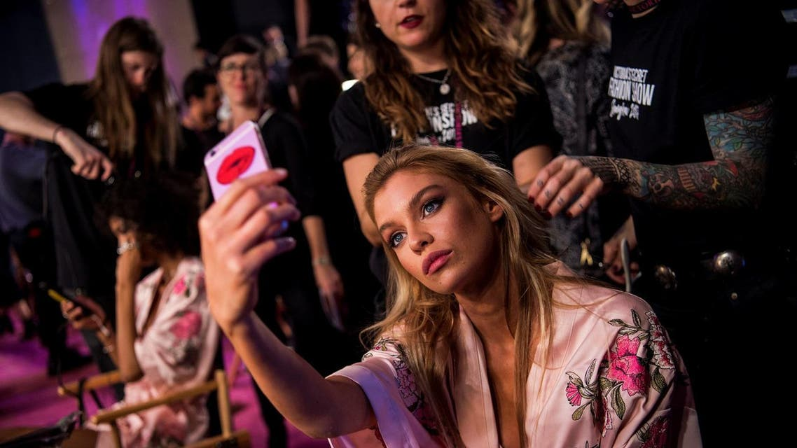 Stella Maxwell takes a selfie backstage before the start of the 2017 Victoria's Secret Fashion Show in Shanghai on November 20, 2017. (AFP)