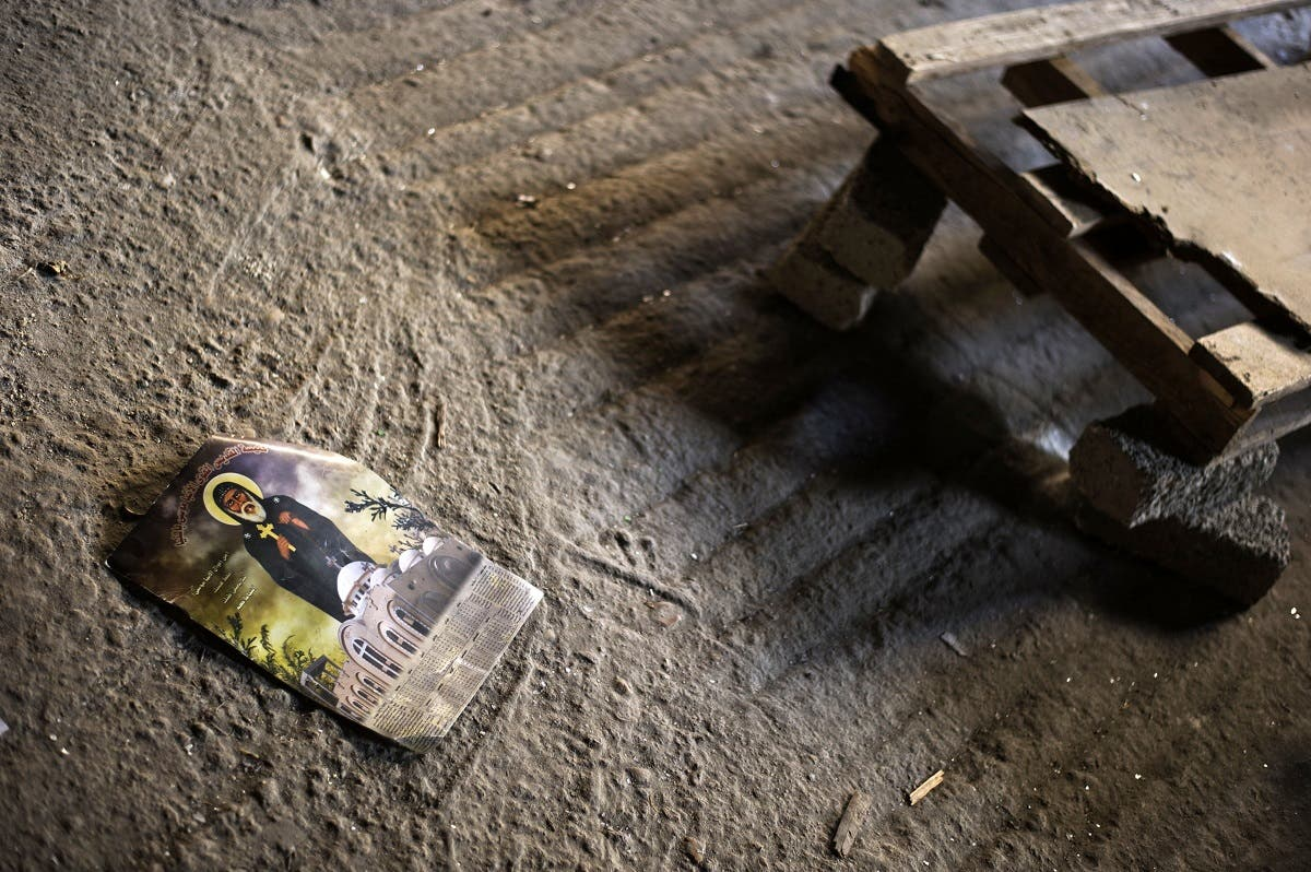 A religious picture remains on the ground on August 27, 2013 in the central Egyptian city of Minya inside Amba Moussa Coptic church that was vandalized and torched by unknown assailants. (AFP)