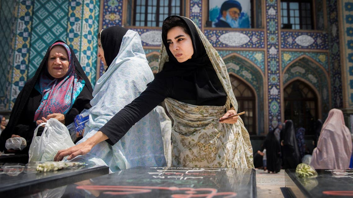 Women pray for unknown Iranian soldiers who were killed during the 1980-1988 Iran-Iraq war at the Imamzadeh Saleh holy shrine in Tehran on August 2, 2017. (Reuters)