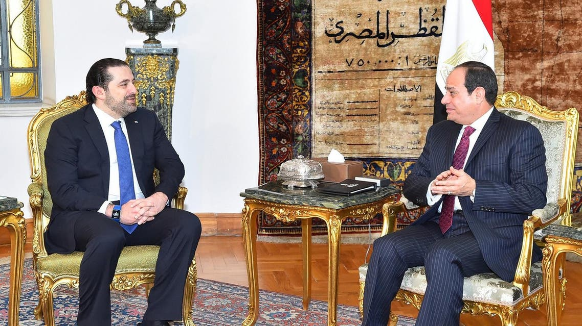 A handout picture released by the Egyptian Presidency shows Egyptian President Abdel Fattah al-Sisi (R) meeting with Lebanese Prime Minister Saad Hariri at the presidential palace in Cairo on March 22, 2017.  Handout / EGYPTIAN PRESIDENCY / AFP
