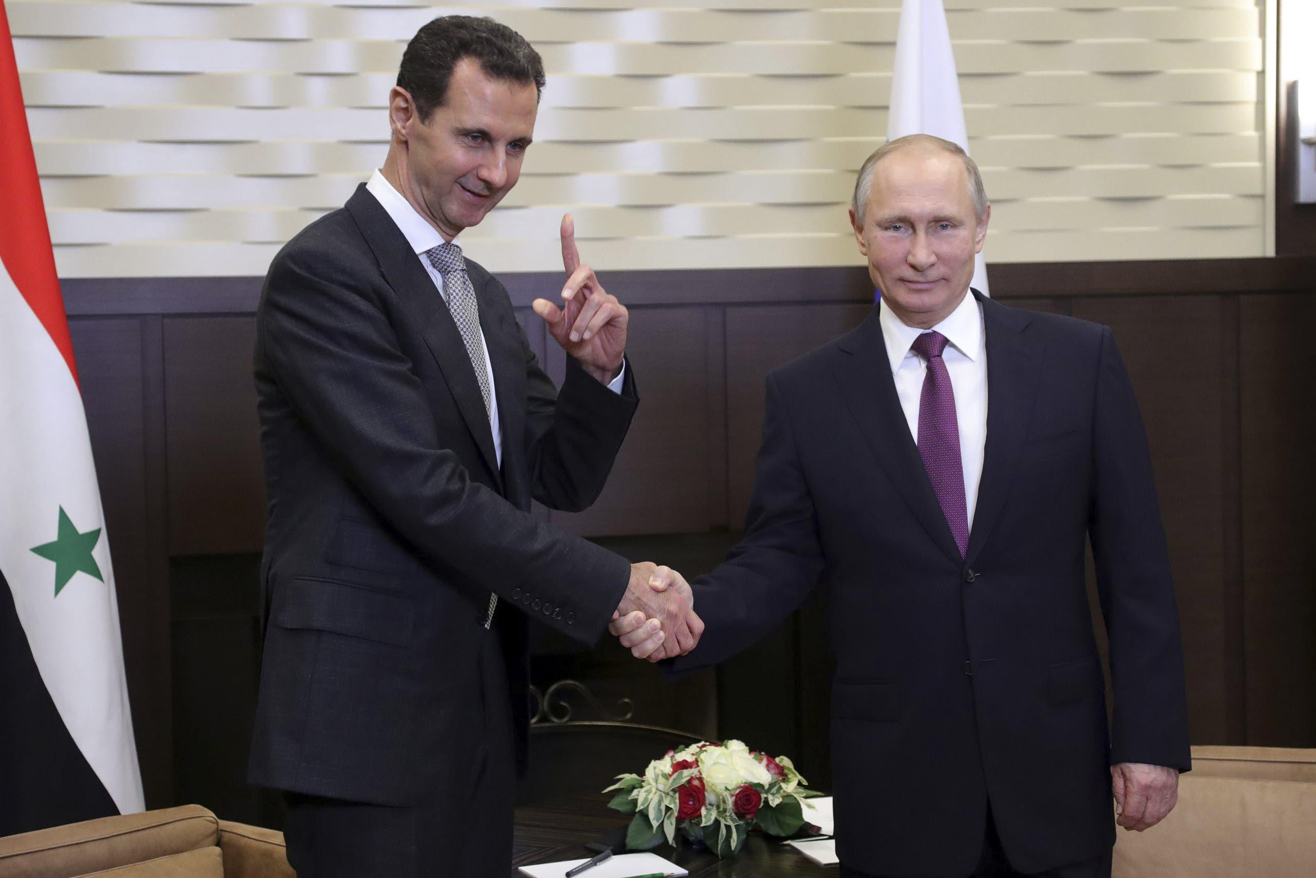 Putin with Bashar al-Assad in the Black Sea resort of Sochi, Russia, on November 20, 2017. (Reuters)