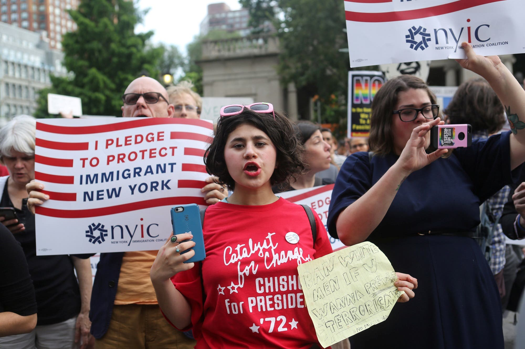Protesters chant slogans against Trump's limited travel ban, approved by the US Supreme Court, in New York City, on June 29, 2017. (Reuters)