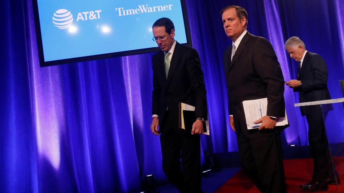 CEO of AT&T Randall Stephenson (L) with David McAtee (C), SEVP and General Counsel for AT&T, in New York City on November 20, 2017. (Reuters)