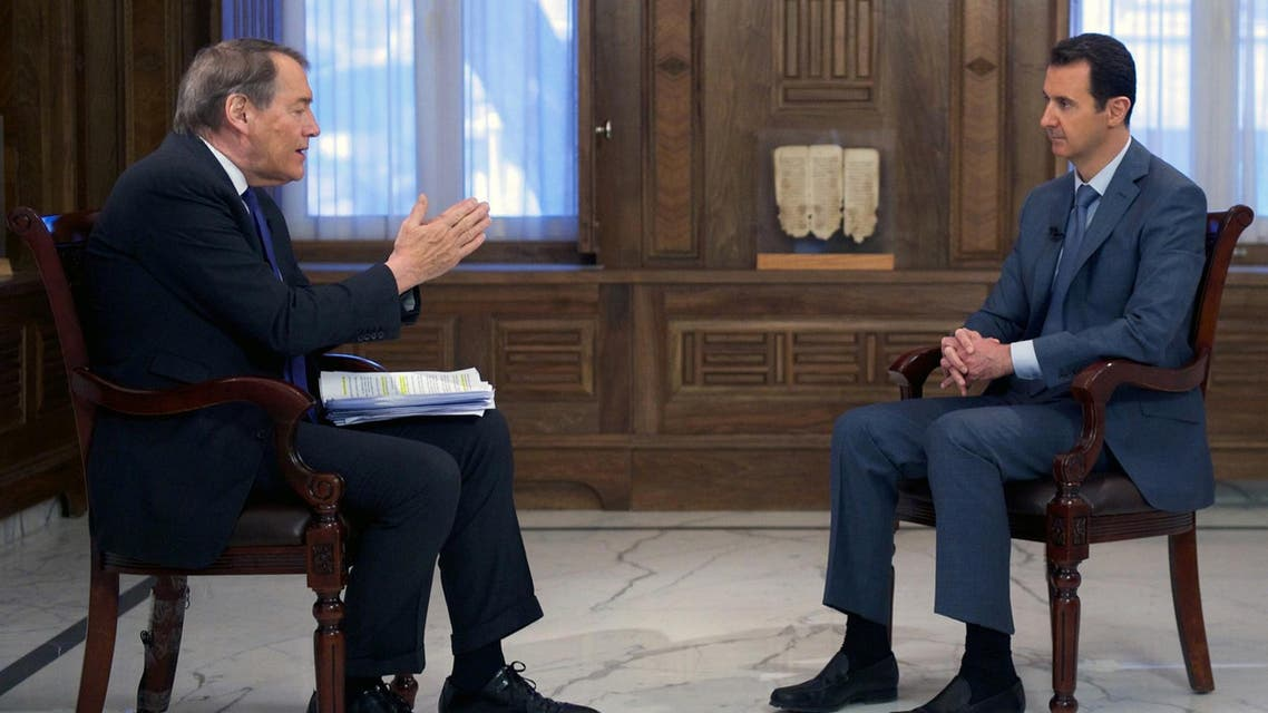 """Syrian President Bashar al-Assad being interviewed by talk show host Charlie Rose from CBS television's """"60 minute"""" program. (File Photo AFP)"""