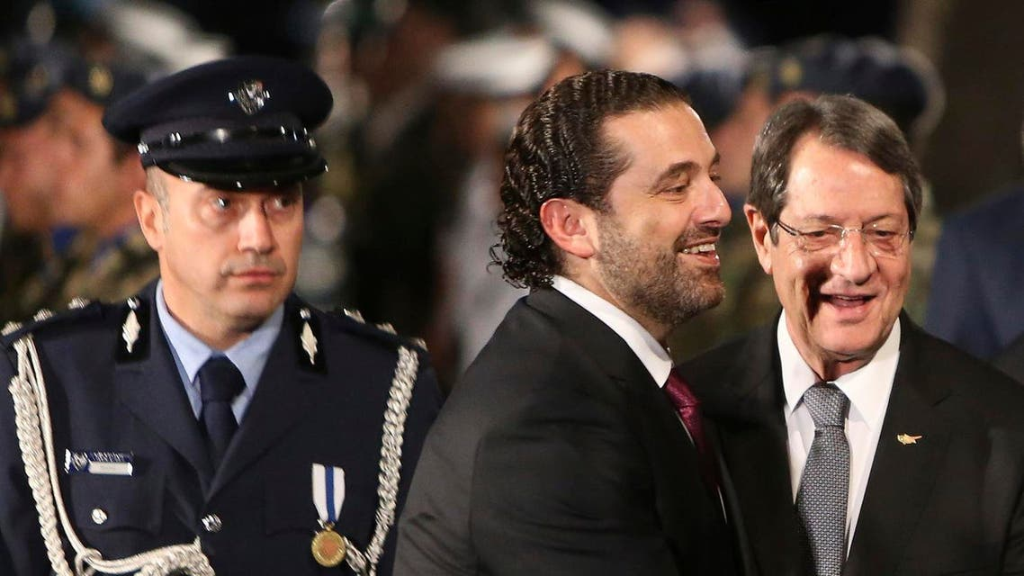 Lebanese Prime Minister Saad Hariri, center, and Cyprus President Nicos Anastasiades smile after they review a military guard of honor during the welcoming ceremony before a meeting at the presidential palace in Nicosia, Cyprus, on Saturday, Oct. 28, 2017. (AP)