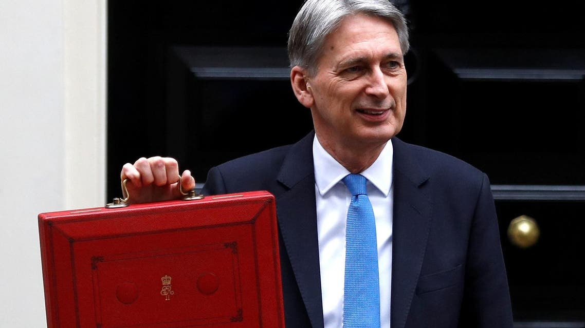 Britain's Finance Secretary Philip Hammond leaves Downing Street on his way to deliver his budget statement to parliament, London, on  November 22, 2017. (Reuters)