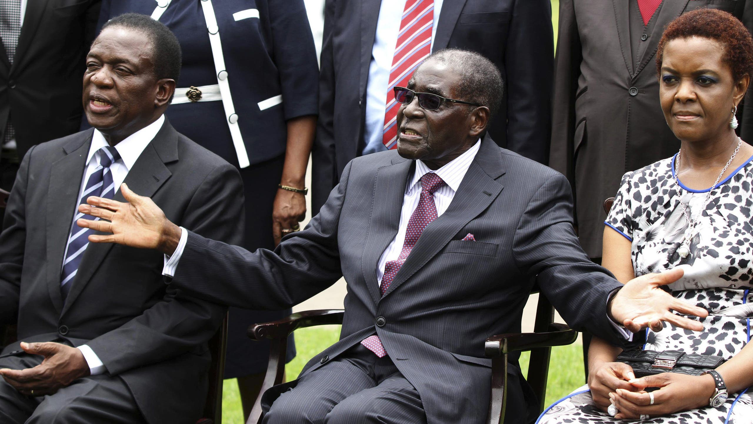 In happier times, perhaps. Zimbabwe's President Robert Mugabe (C) sits with his wife Grace and Emmerson Mnangagwa (L). (Reuters/Philimon Bulawayo)
