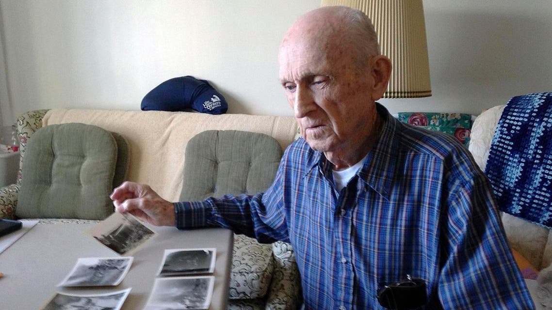 World War II veteran Kenneth F. Lincoln, 90, looks at photos in his North Attleborough, Mass., home that were taken when he was serving in the U.S. Navy. (AP)
