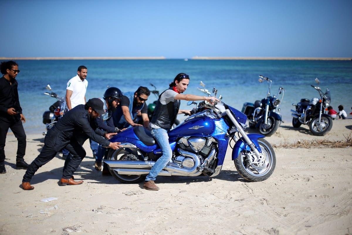 Members of the Tripoli bikers group ride their motorbikes at the beach in Tripoli, Libya. (Reuters)