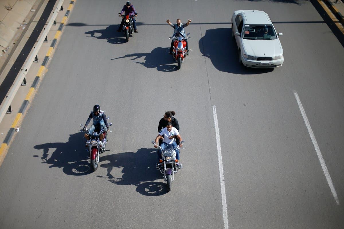Members of the Tripoli bikers group ride their motorbikes on the streets of Tripoli, Libya. (Reuters)