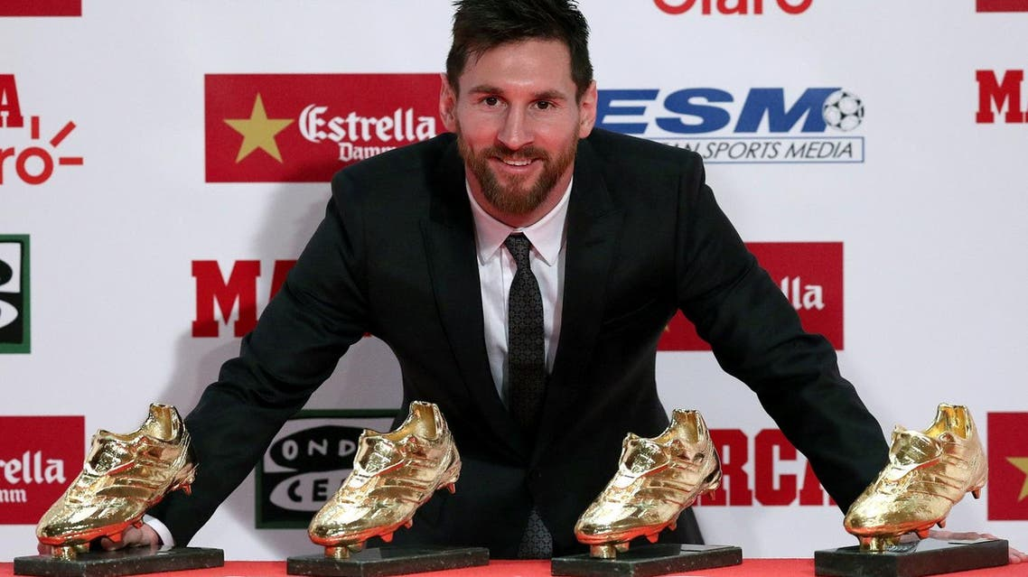 Lionel Messi poses with his four Golden Boot trophies during a ceremony in Barcelona, Spain, on November 24, 2017. (Reuters)