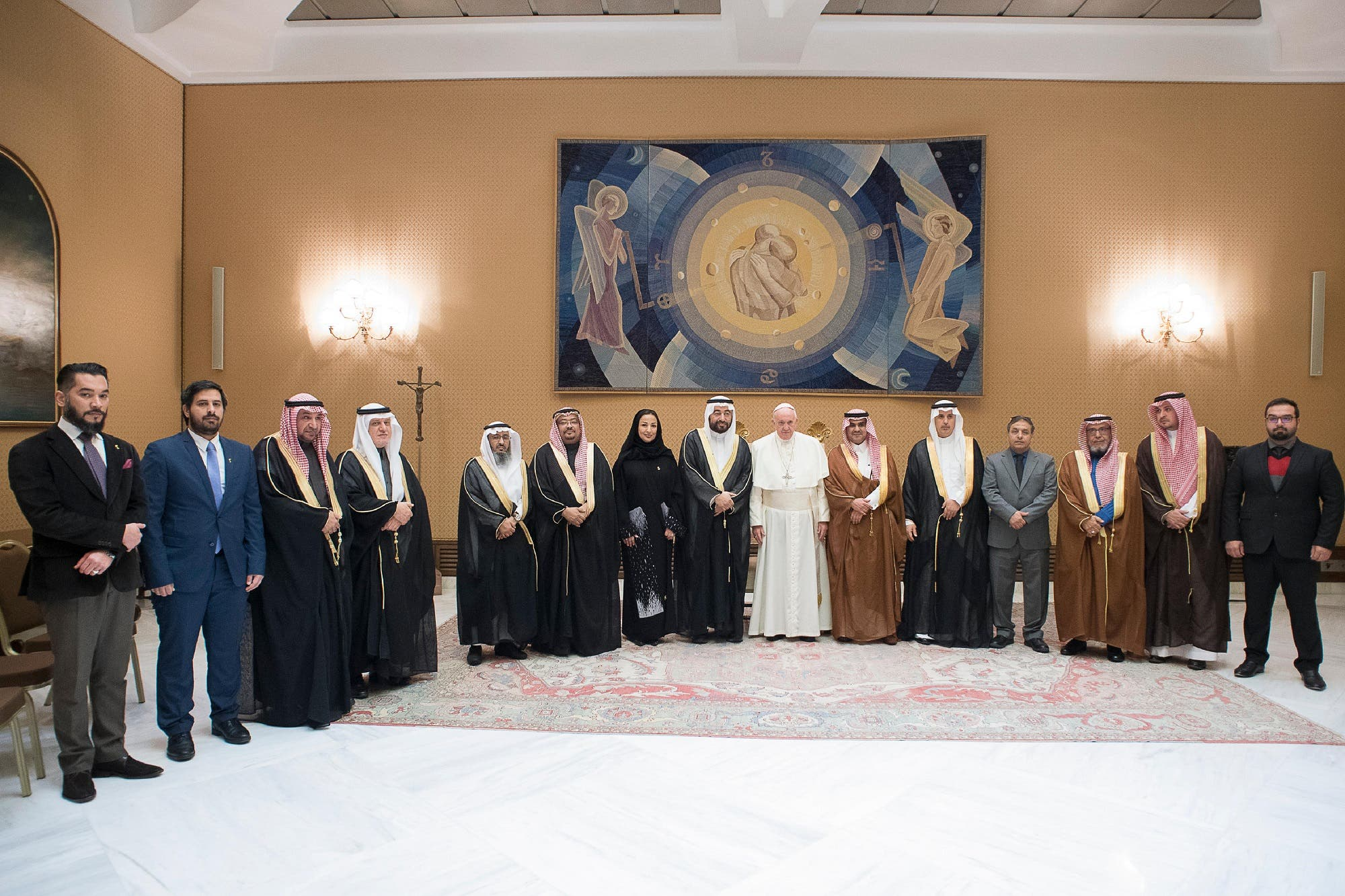 This handout picture released by the Vatican press office shows Pope Francis (C) posing with the delegation of Abdullah bin Fahad Allaidan at the Vatican on November 22, 2017. (AFP)