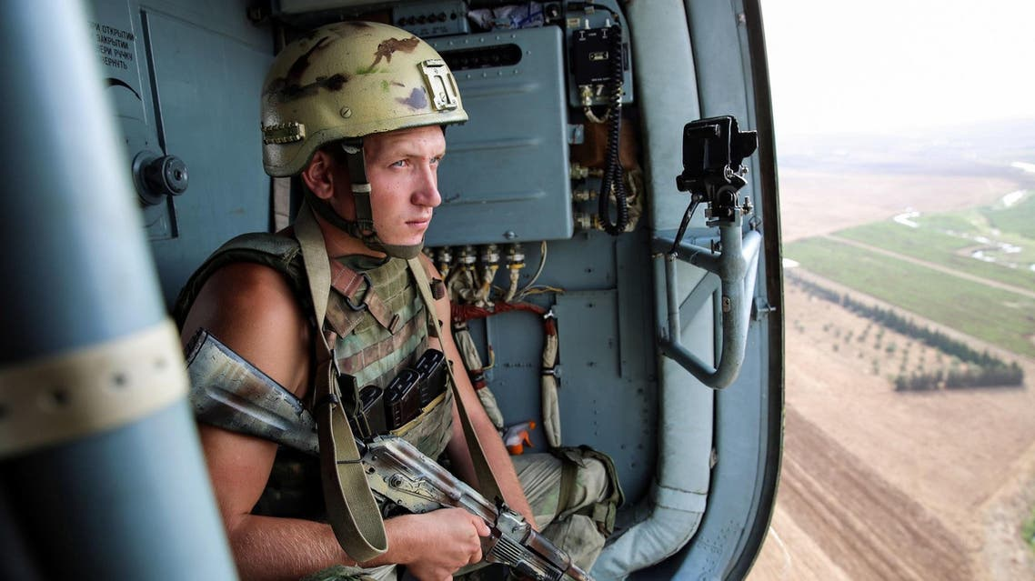A Russian soldier riding in a helicopter en route to Deir Ezzor on September 15, 2017. (AFP)