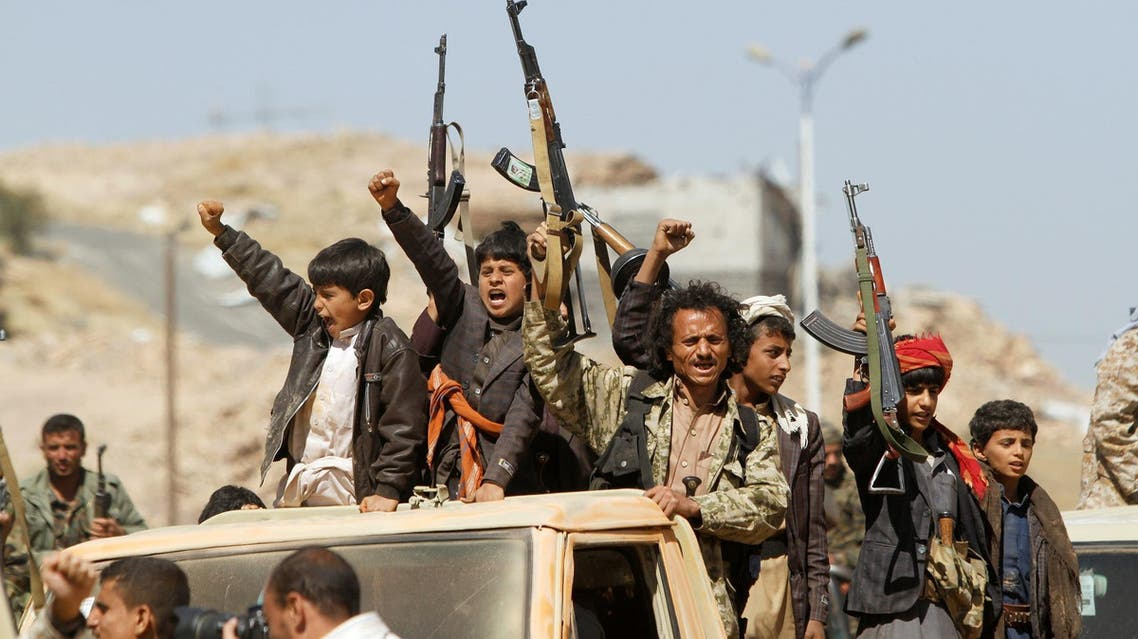 Newly recruited Houthi fighters gesture in Sanaa as they ride a car before heading to the frontline on November 16, 2017. (Reuters)