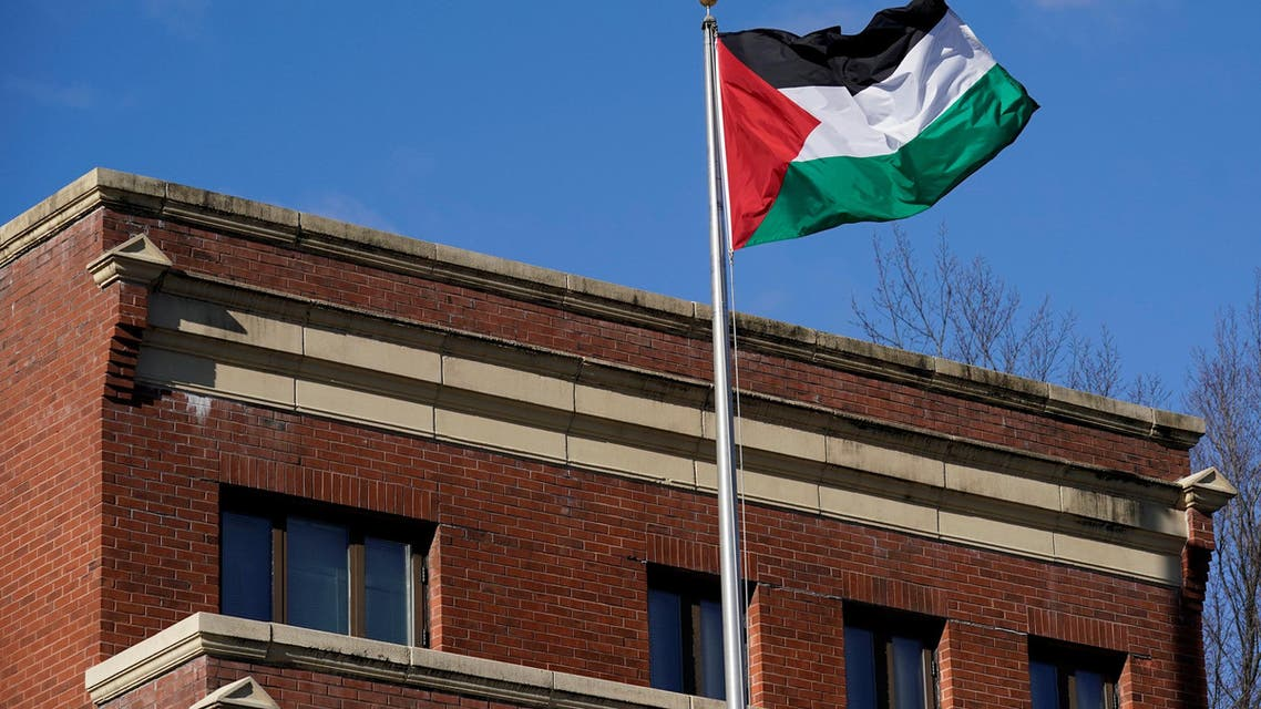 Palestinian flag waves at Palestine Liberation Organization office in Washington, U.S., November 19, 2017. U.S. State Department official said that under legislation passed by Congress, Secretary of State Rex Tillerson could not renew a certification that expired this month for the PLO office. REUTERS/Yuri Gripas
