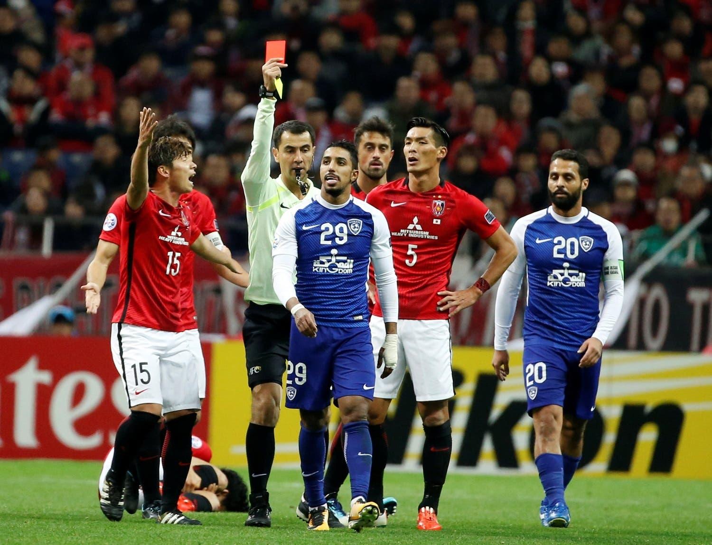 Al Hilal's Salem Al Dawsari receives a red card. (Reuters)