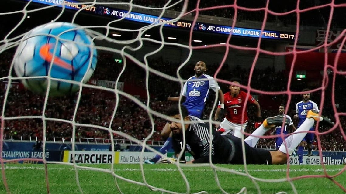 Urawa Red Diamonds' Rafael Da Silva scores his goal against Saudi Arabia's Al Hilal's goalkeeper Abdullah Al-Maiouf in the Champions League final, second leg, at Saitama Stadium, Japan. (Reuters)