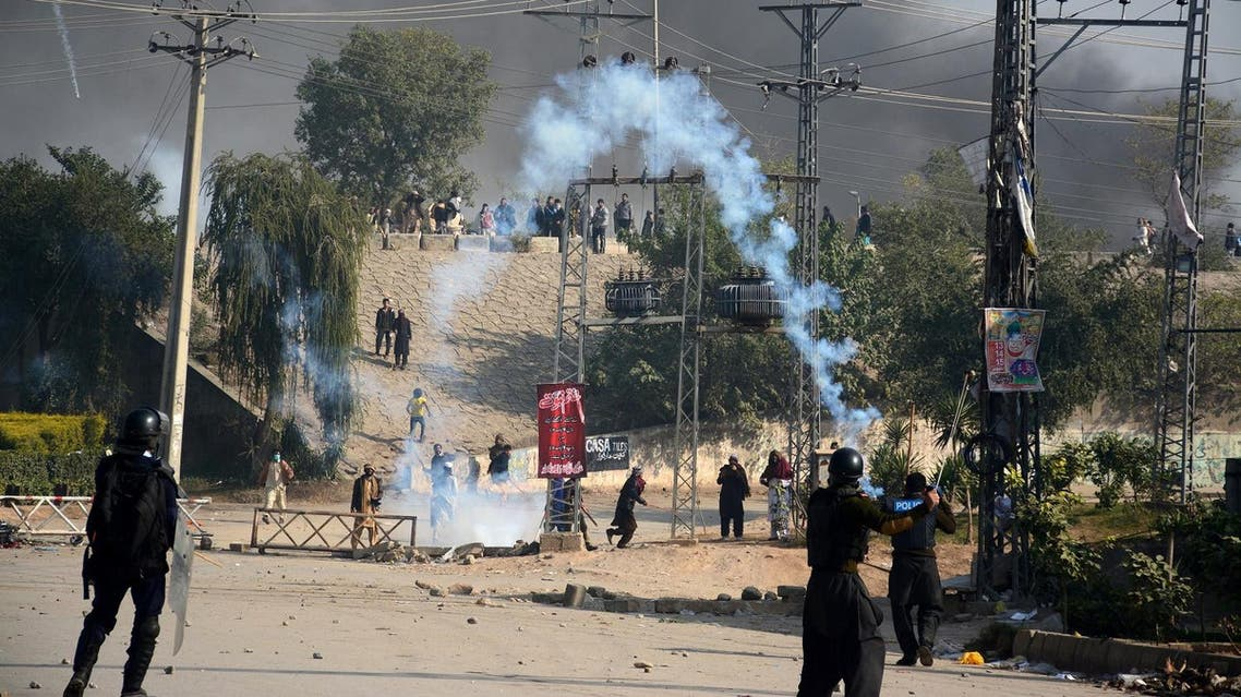 Police fire tear gas during clashes with protesters at Faizabad junction in Islamabad, Pakistan, on November 25, 2017. (Reuters)