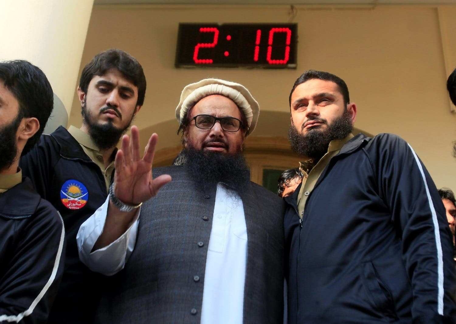Hafiz Saeed speaks with supporters after attending Friday Prayers in Lahore, Pakistan November 24, 2017. (Reuters)