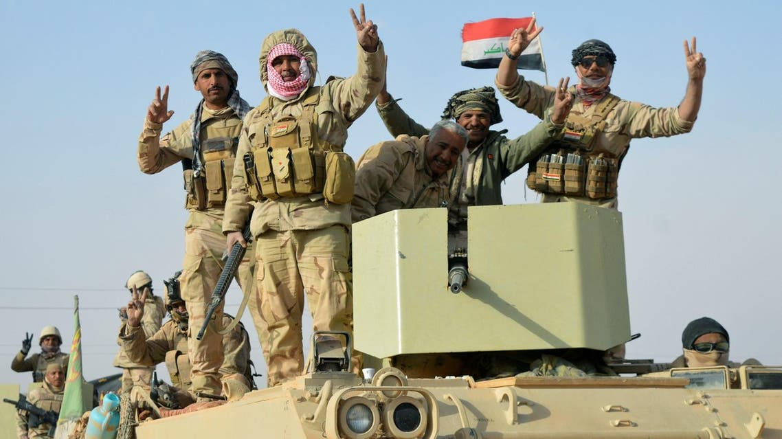Iraqi security forces after taking control of the border town of Rawa, the last town under the control of the ISIS in Iraq on November 17, 2017. (Reuters)