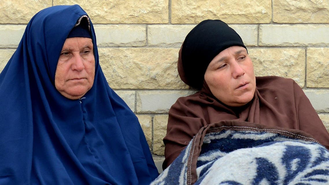 Relatives of the victims of the bomb and gun assault on the North Sinai Rawda mosque sit outside the Suez Canal University hospital in the eastern port city of Ismailia on November 25, 2017