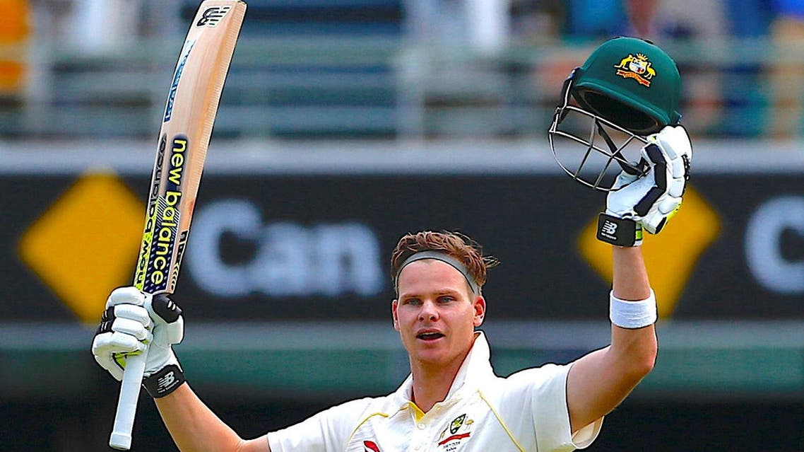 Australia's captain Steve Smith celebrates after reaching his century during the third day of the first Ashes cricket test match. (Reuters)