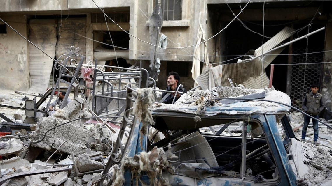 Syrian residents are seen reacting after shelling in Douma, in the eastern Damascus suburb of Ghouta, Syria, on November 17, 2017. (Reuters)