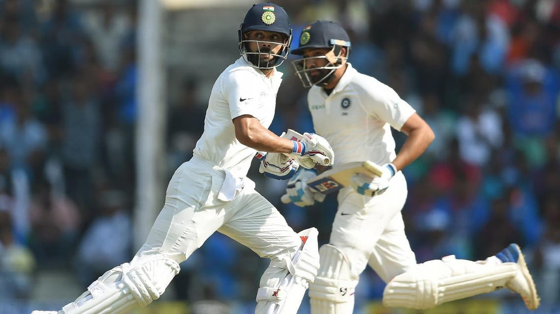 Indian cricketers Virat Kohli (left) and Rohit Sharma run between the wickets on the third day of the second Test cricket match against Sri Lanka in Nagpur on November 26, 2017. (AFP)