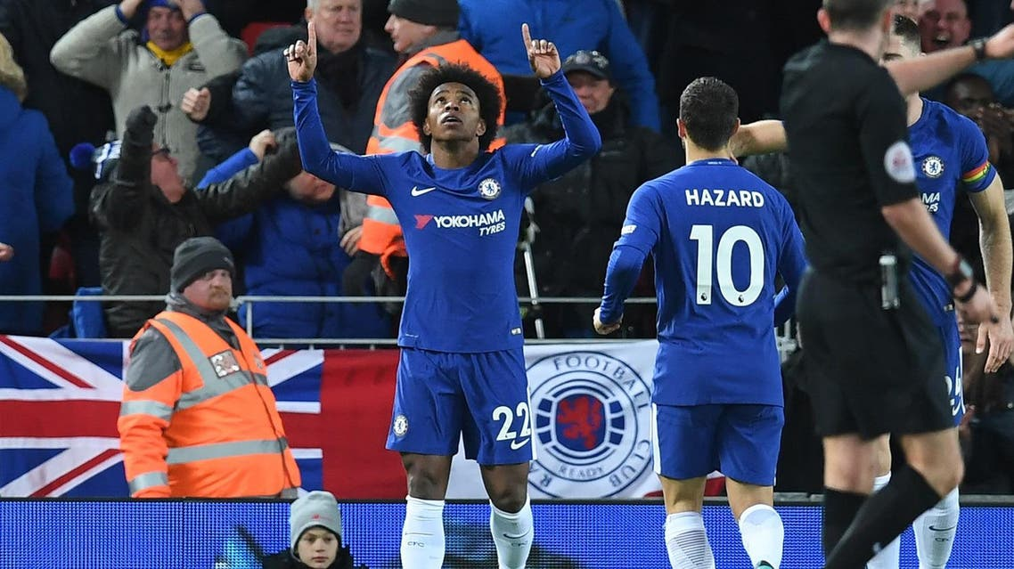 Chelsea's Brazilian midfielder Willian (C) celebrates after scoring their first goal during the English Premier League football match between Liverpool and Chelsea at Anfield in Liverpool, north west England on November 25, 2017.  Paul ELLIS / AFP