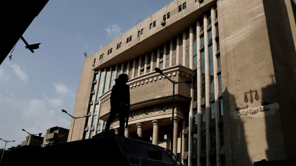 Egyptian security officers guard a courthouse AP